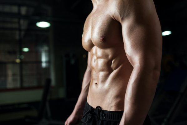close up of male body or bare torso in gym